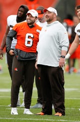 Browns quarterback Baker Mayfield talks with coach Freddie Kitchens at the team's training facility in Berea, Ohio.