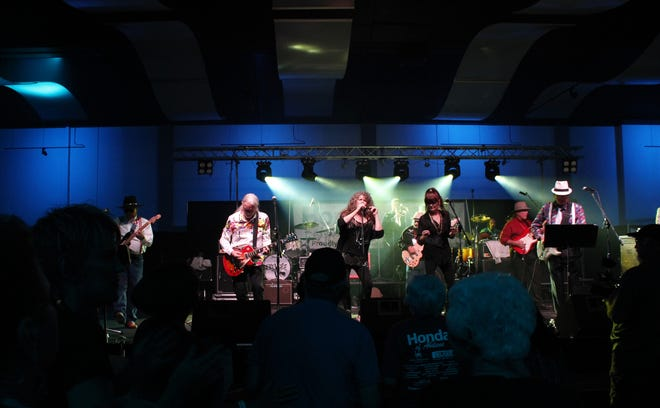 Dancers and those just groovin' to the music crowded the stage throughout the 10th anniversary of Garageband Woodstock in July 2019 at the Abilene Convention Center. The 2020 event was canceled due to the pandemic but is back this weekend.