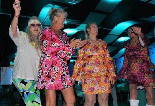 Sandy Fullerton, second from left, and her friends were dressed for flower power, not girl power, Saturday at the 10th Garageband Woodstock at the Abilene Convention Center.