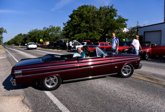 Terry Cate parks his1964 Ford Falcon convertible Saturday in Lawn. The Main Street Lawn Car Show benefitted On the Way Home Ministries, a local nonprofit that runs a food pantry and provides education and training for those in need.