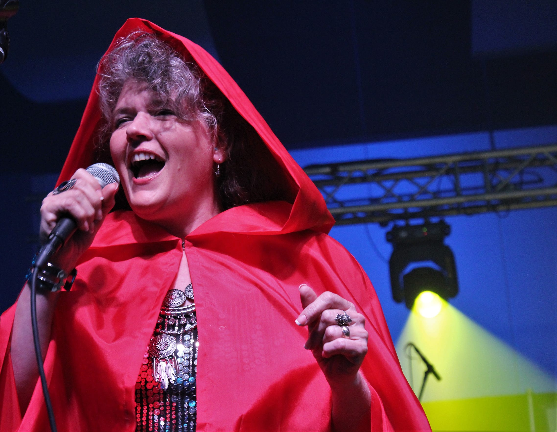 """A 1966 hit was """"Little Red Riding Hood,"""" but for Sam the Sham and the Pharaohs. The Doug Roysden Band in the 1990s recorded an update, with a comeback from Little Red Riding Hood. Singing the part is Shannon Roysden, in her cape, at Garageband Woodstock in July."""