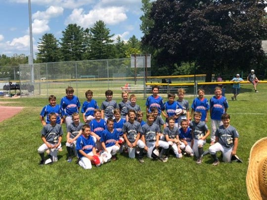 The Bennington and Essex Town all-stars pose for a picture following the 8- and 10-year-old Little League baseball state championship game.