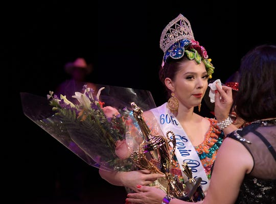 Melissa Calderon has tears wiped from her face as she's crowned the 60th annual Feria de las Flores, Saturday, July 27, 2019.