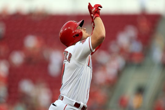 Jul 27, 2019; Cincinnati, OH, USA; Cincinnati Reds second baseman Josh VanMeter (17) celebrates hitting a solo home run against the Colorado Rockies in the second inning at Great American Ball Park.