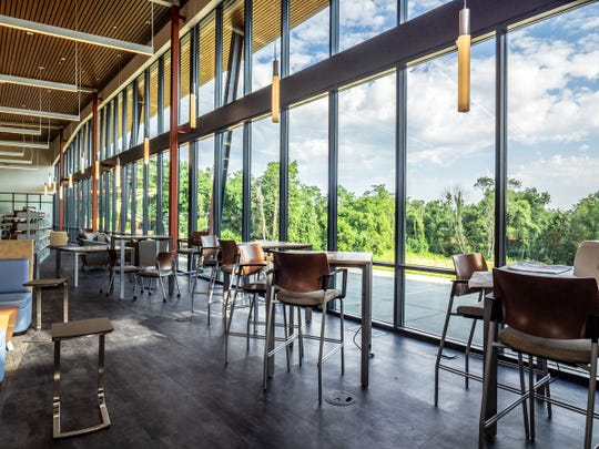 A wall of windows facing West at Boone County Public Library's new Hebron Branch lets natural light into a reading lounge.