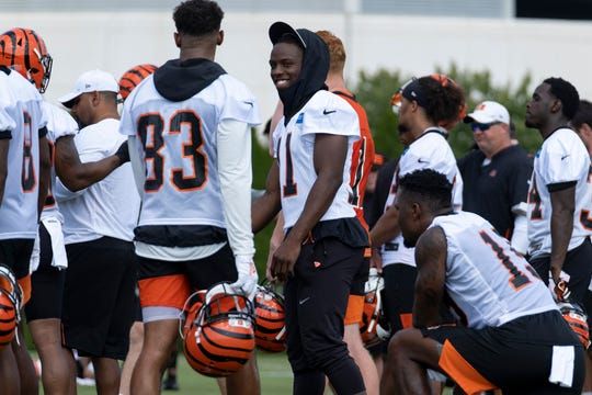 Cincinnati Bengals wide receiver John Ross III smiles during training camp at Paul Brown Stadium on Sunday July 28, 2019.