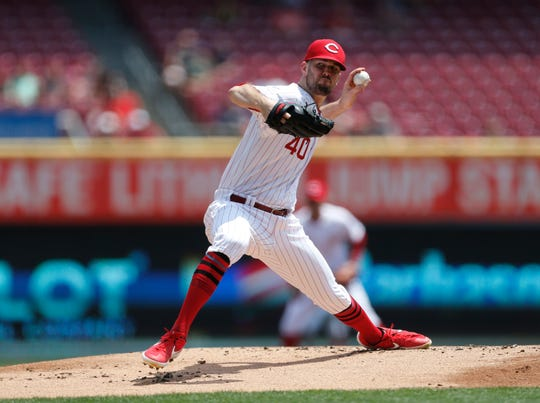 Cincinnati Reds starting pitcher Alex Wood (40) throws against the Colorado Rockies during the first inning of a baseball game, Sunday, July 28, 2019, in Cincinnati.