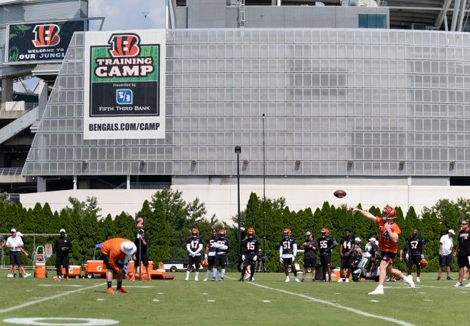 Cincinnati Bengals quarterback Andy Dalton (14) throws the ball during training camp at Paul Brown Stadium on Sunday July 28, 2019.