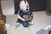 Jake Hilmer pretends to be a young catcher.