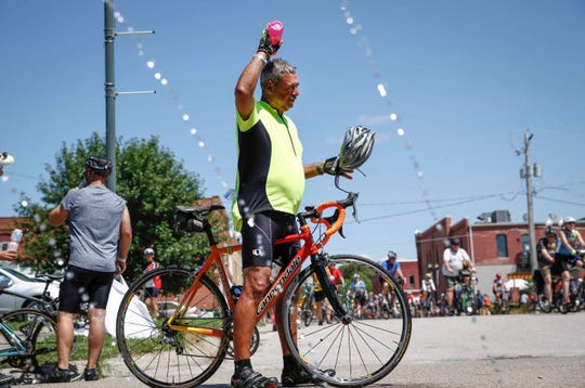 Rick Castorena of Grand Prairie, Texas, cools off in Earlham during RAGBRAI on Monday, July 22, 2019.