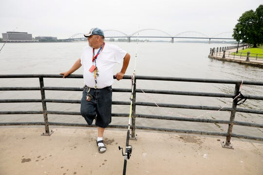 William Roelandt fishes on the Mississippi River, Tuesday, July 16, 2019, in Davenport, Iowa. Hundreds of communities line the Mississippi River, but Davenport is among the few where people can dip their toes into the water without scaling a flood wall or levee.
