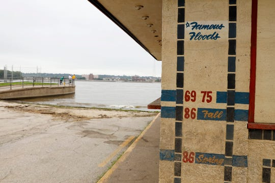 A vendor shack near the Mississippi River shows high water marks from past floods, Tuesday, July 16, 2019, in Davenport, Iowa. Hundreds of communities line the Mississippi River, but Davenport is among the few where people can dip their toes into the water without scaling a flood wall or levee.