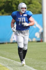 Lions defensive end Mitchell Loewen runs a lap during practice during training camp on Sunday, July 28, 2019, in Allen Park.