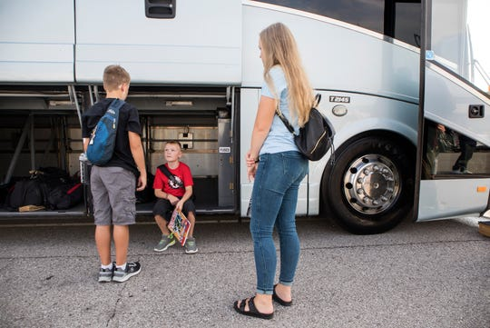 From left, Brady Lockwood, 12,  Jocelyn Lockwood, 16, and Cyrus Lockwood, 7, wait for Democratic presidential candidate and U.S. Sen. Bernie Sanders to ride a bus from Detroit to Canada on Sunday to purchase insulin. The three siblings have Type 1 diabetes.