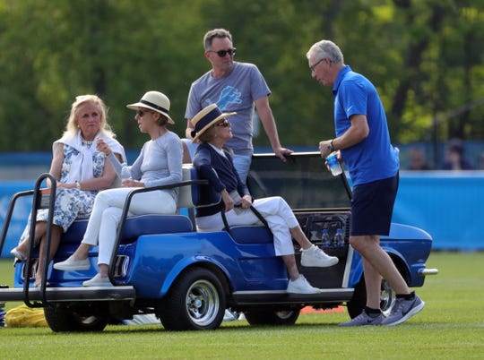 Congresswoman Debbie Dingell, Steve Hamp, Lions owner Martha Firestone Ford and team president Rod Wood talk during practice during training camp on Sunday, July 28, 2019, in Allen Park.