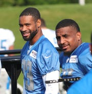 Lions defensive backs Darius Slay, left, and Quandre Diggs, right, during training camp Sunday, July 28, 2019, in Allen Park.