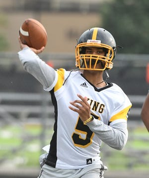Detroit King freshman quarterback Dante Moore received his first Division I offer before he started eighth grade.