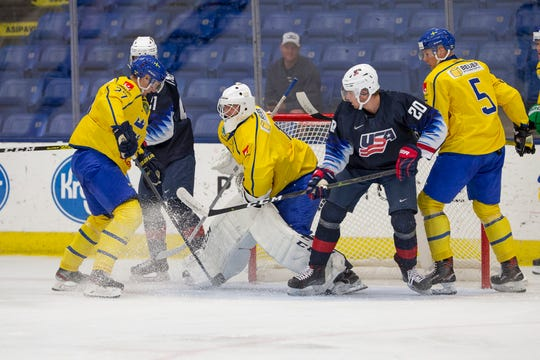Red Wings' goalie prospect Jesper Eliasson makes a save for Sweden in a 4-2 loss against USA Blue at the World Junior Summer Showcase at USA Hockey Arena in Plymouth.