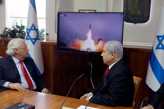 Israeli Prime Minister Benjamin Netanyahu, right, and U.S. Ambassador to Israel David Friedman watch a video which shows the launch of the Arrow 3 hypersonic anti-ballistic missile during a cabinet meeting in Jerusalem Sunday.