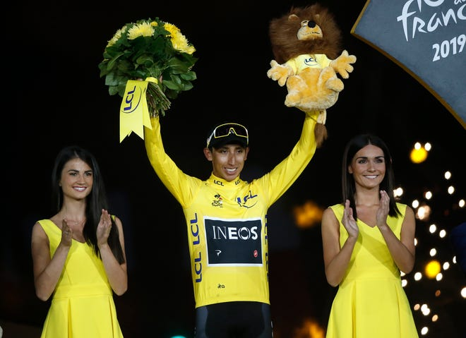 Colombia's Egan Bernal stands on the podium after winning the 2019 Tour de France.