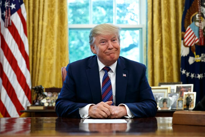 President Donald Trump pauses as he speaks in the Oval Office of the White House in Washington, Friday, July 26, 2019. Trump announced that Guatemala is signing an agreement to restrict asylum applications to the U.S. from Central America. (AP Photo/Carolyn Kaster)