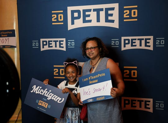 Huge mayor Pete fans, Gabrielle Faisal, 7, and her mother, Christie Faisal both of Detroit pose at a photo booth before the Grassroots Event for South Bend mayor and Democratic presidential candidate Pete Buttitieg at The Fillmore in Detroit on July 28, 2019.  (Robin Buckson / The Detroit News)