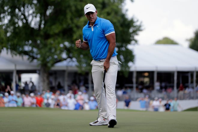 Brooks Koepka celebrates a birdie putt on the 17th green during the final round of the World Golf Championships-FedEx St. Jude Invitational.