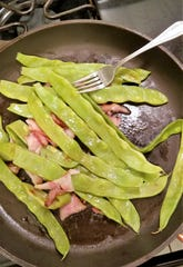 We cooked our giant green beans with a little bacon and no water in a covered skillet and found them sweet and tender.
