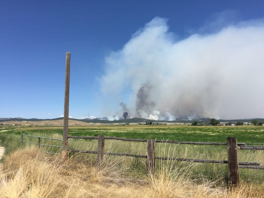The north hills fire kicks up smoke north of Lincoln Road Sunday afternoon, when the blaze had burned 2,600 acres.