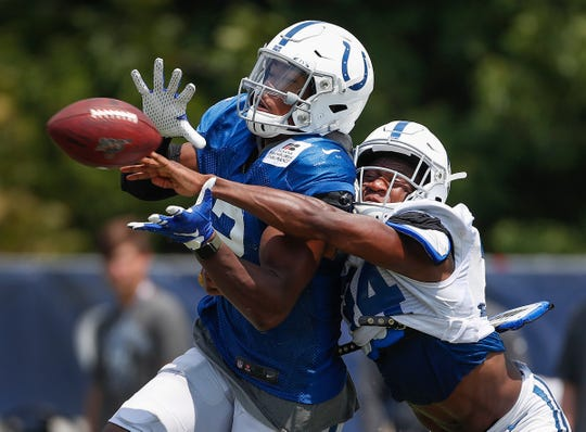 Indianapolis Colts wide receiver Jordan Veasy (2) attempts to catch the ball as cornerback Rock Ya-Sin (34) defends during day 4 of the Colts preseason training camp practice at Grand Park in Westfield on Sunday, July 28, 2019.