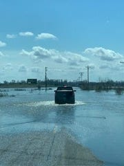 Terry and Susan Ecker driving to an airboat in spring 2019 during heavy flooding near their Elmo, Missouri, home.