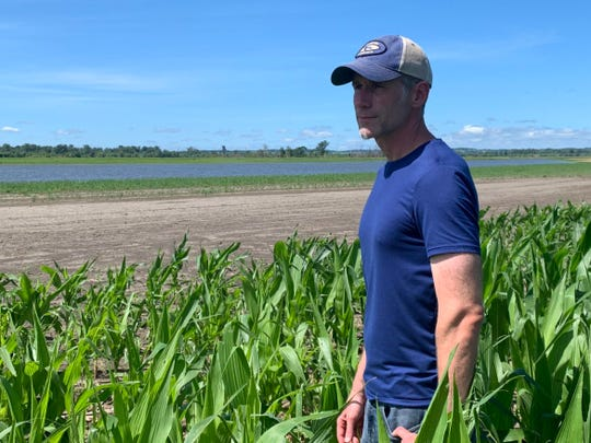 Corey McIntosh, a fifth-generation farmer near Missouri Valley, Iowa, near his house in June 2019.