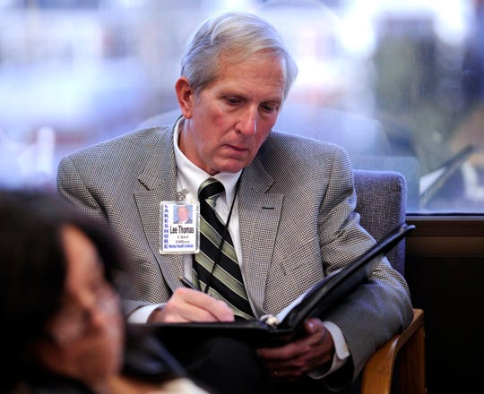 Lakeshore Mental Health Institute Chief Officer Lee Thomas takes notes during a meeting with Tennessee Department of Mental Health Commissioner Doug Varney Wednesday, Dec. 14, 2011 in Knoxville, Tenn. Varney met with Knox County Commissioners who have said they were blindsided by the state proposal to close Lakeshore.
