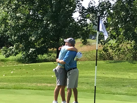 Nic Hofman, left, shares a hug with his father, Brent, after winning the 2018 Lafayette Men's City Golf championship.