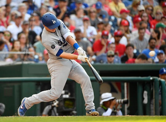 Los Angeles Dodgers catcher Will Smith (16) hits a three run RBI double against the Washington Nationals during the seventh inning at Nationals Park in Washington, D.C., on Saturday, July 27, 2019.