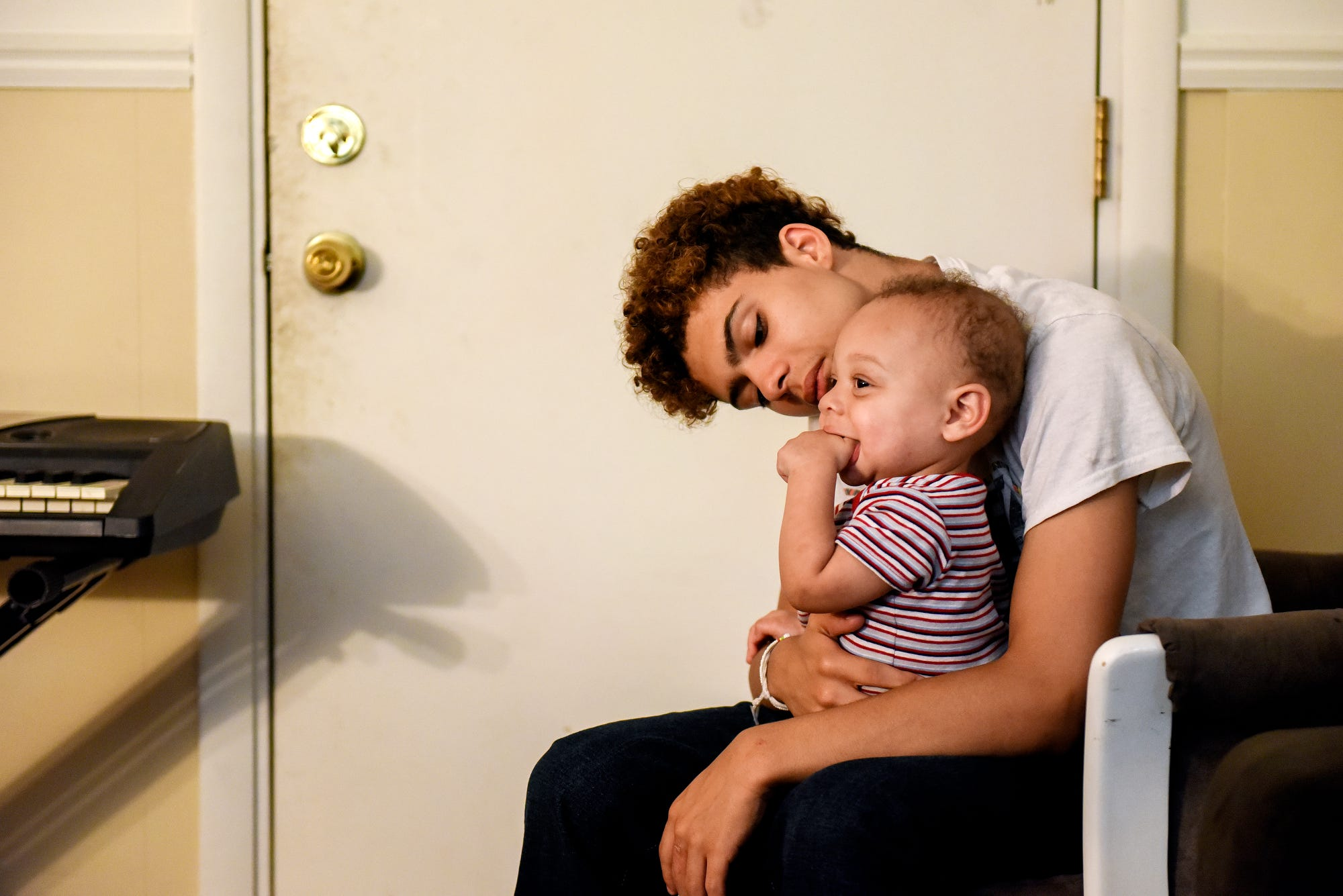 Lazarus Meissner, right, spends time with his 13-month-old son Jaylen Gomez-Meissner at their home on Friday, July 26, 2019, in Lansing.