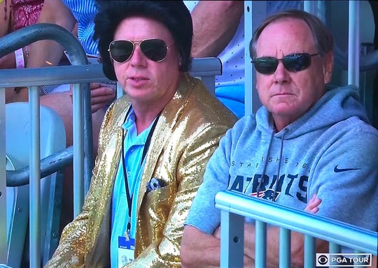 Fans dressed as Elvis Presley and Patriots coach Bill Belichick take in the action Sunday at the WGC-FedEx St. Jude Invitational at TPC Southwind.