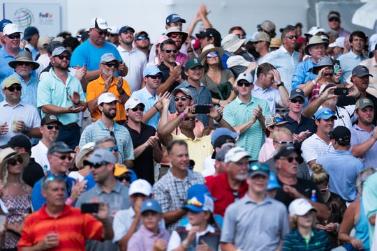 Fans react to Brooks Koepka's winning putt on No. 18 on July 28 at the WGC-FedEx St. Jude Invitational. The average economic impact of past FedEx St. Jude Classic competitions was usually about $20 million. Officials expect this year's WGC event doubled the financial impact on the area.