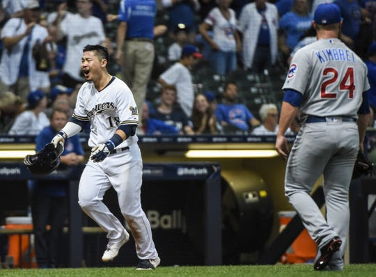 Brewers rookie sensation Keston Hiura his enjoying is game-winning two-run home run in the 10th as he heads up the third base line past Cubs closer Craig Kimbrel.