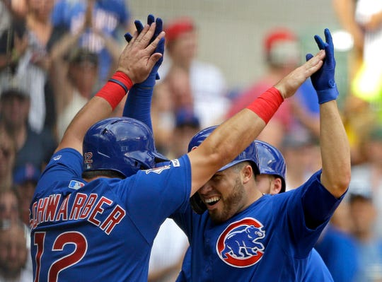 The Cubs' Victor Caratini is congratulated by Kyle Schwarber after hitting a three-run home run during the sixth inning.