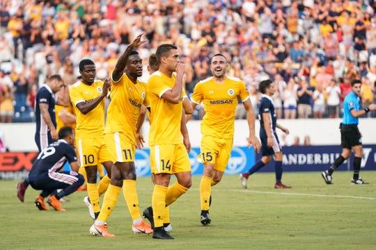 Members of Nashville SC celebrating Daniel Rios' goal vs. Indy Eleven.