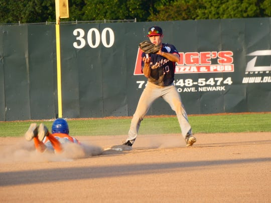 Licking County shortstop Casimer Sobaszek attempts to turn a double play Saturday during Game 1 of the Settlers' Great Lakes Summer Collegiate League championship series against the Lima Locos at Don Edwards Park.