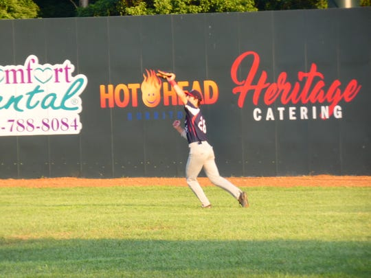 Sam Wilson, shown making a catch Saturday night, had three hits and three runs scored to lead the Licking County Settlers to a 9-6 victory Sunday.