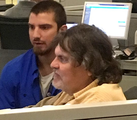 Rich Liebson works with reporter Christopher Eberhart to polish a story. Liebson was a mentor to a generation of Journal News/lohud reporters.