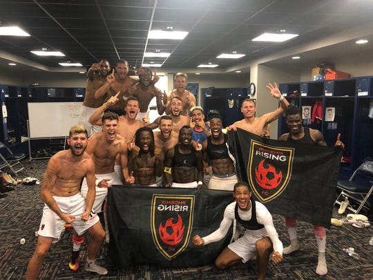 Members of Rising FC celebrate of winning their 11-straight game, a United  Soccer League record.
