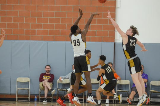 Jul. 26, 2019; TJ Bamba shoots over a defender at the NCAA West Region Basketball Academy in Grand Canyon University.