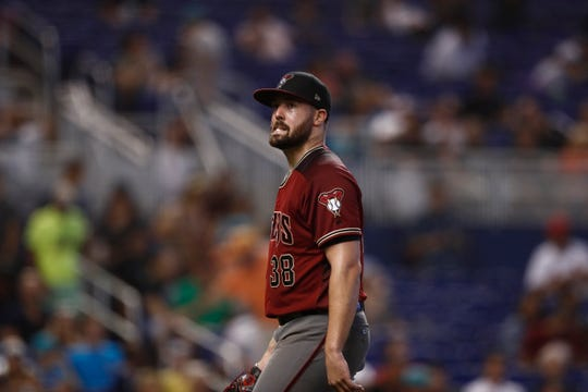 Arizona Diamondbacks starting pitcher Robbie Ray (38) walks off the field after the fifth inning of a baseball game against the Miami Marlins on Sunday, July 28, 2019, in Miami.