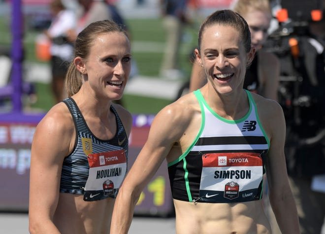 Shelby Houlihan, left, and Jenny Simpson congratulate one another after their 1-2 finish in the 1,500 at the 2018 U.S. Outdoor Track Championships.