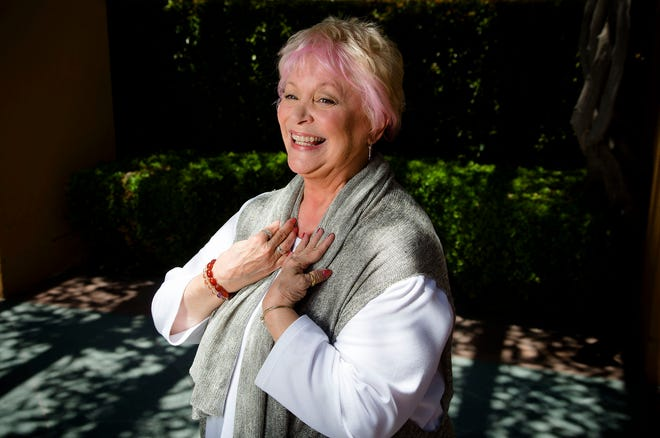 In this June 3, 2014 photo, Disney legend Russi Taylor stands amidst the long shadows at the Disney Legend Plaza at Disney Studios in Burbank, Calif. Taylor, an actress who for more than three decades gave voice to Minnie Mouse, has died on Friday, July 26, 2019, at age 75.