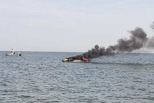 Three people were rescued following this boat fire in Lake Erie on Saturday.
